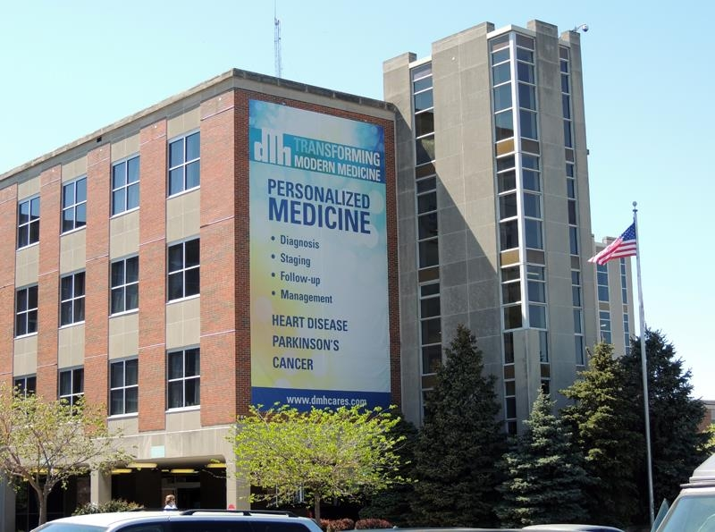 Giant banner hung on the side of the DMH main entrance