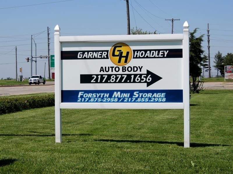 Garner-Hoadley Auto Body's post & panel sign on Rt. 51 north