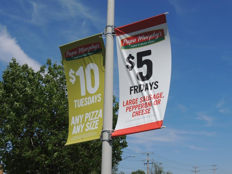 Pole banners on the light posts at Papa Murphy's Pizza