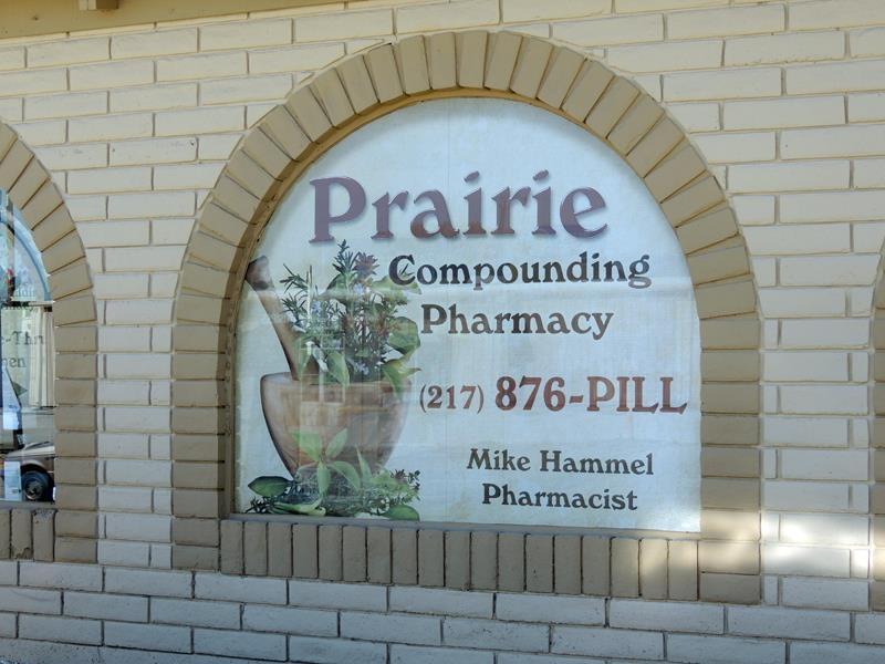 Prairie Pharmacy Compounding window perf graphics